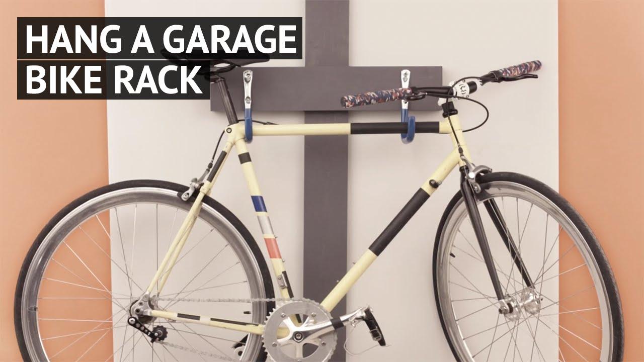 Hang a garage bike rack - YouTube