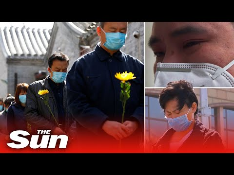China holds moment of mourning for victims of coronavirus outbreak that's swept the world