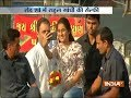 Girl takes a selfie with Rahul Gandhi during his roadshow in Bharuch