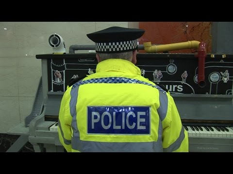 POLICEMAN PLAYS PIANO (then walks away like a boss)