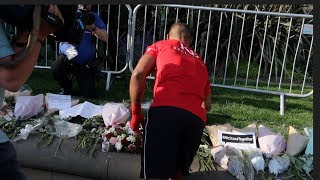 SPECIAL TOUCH - KELL BROOK LAYS FLOWERS DOWN IN SHEFFIELD IN TRIBUTE TO MANCHESTER TRAGEDY