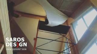 Натяжной потолок Saros Design мансардного типа в загородном доме