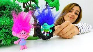 Video mit Trolls Toys: wir spielen mit Knete.