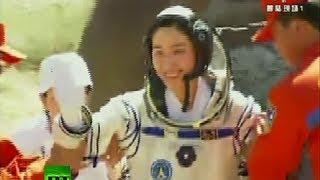 Video of China Shenzhou-9 crew landing after docking mission success