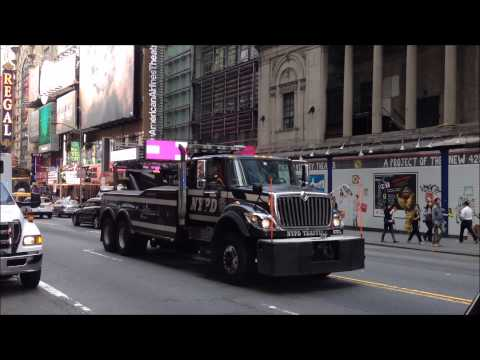 Giant NYPD Tow Truck Wrecker Driving By On West 42nd Street In Midtown Manhattan