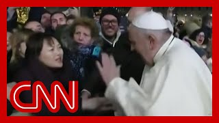 Watch Pope Francis smack woman's hand after being grabbed