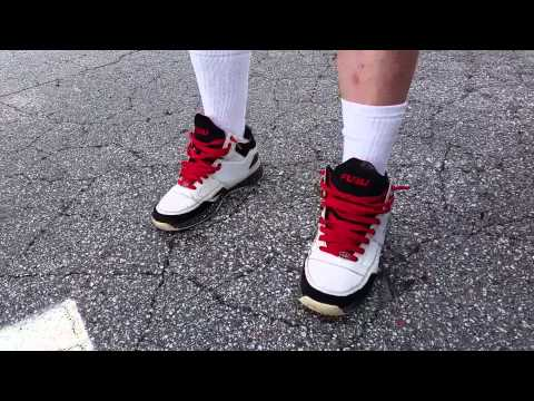 KKK member at Confederate flag rally confronted for wearing FUBU shoes