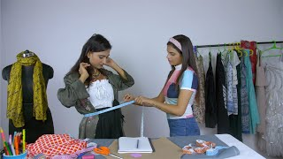 Young female entrepreneur happily dealing with a customer at her fashion boutique