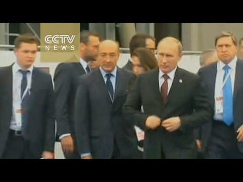 Putin and Ukraine's Poroshenko shake hands on gas deal amid crisis