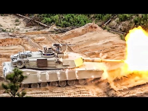 U.S. Armored Vehicles Fire & Maneuver In Estonia