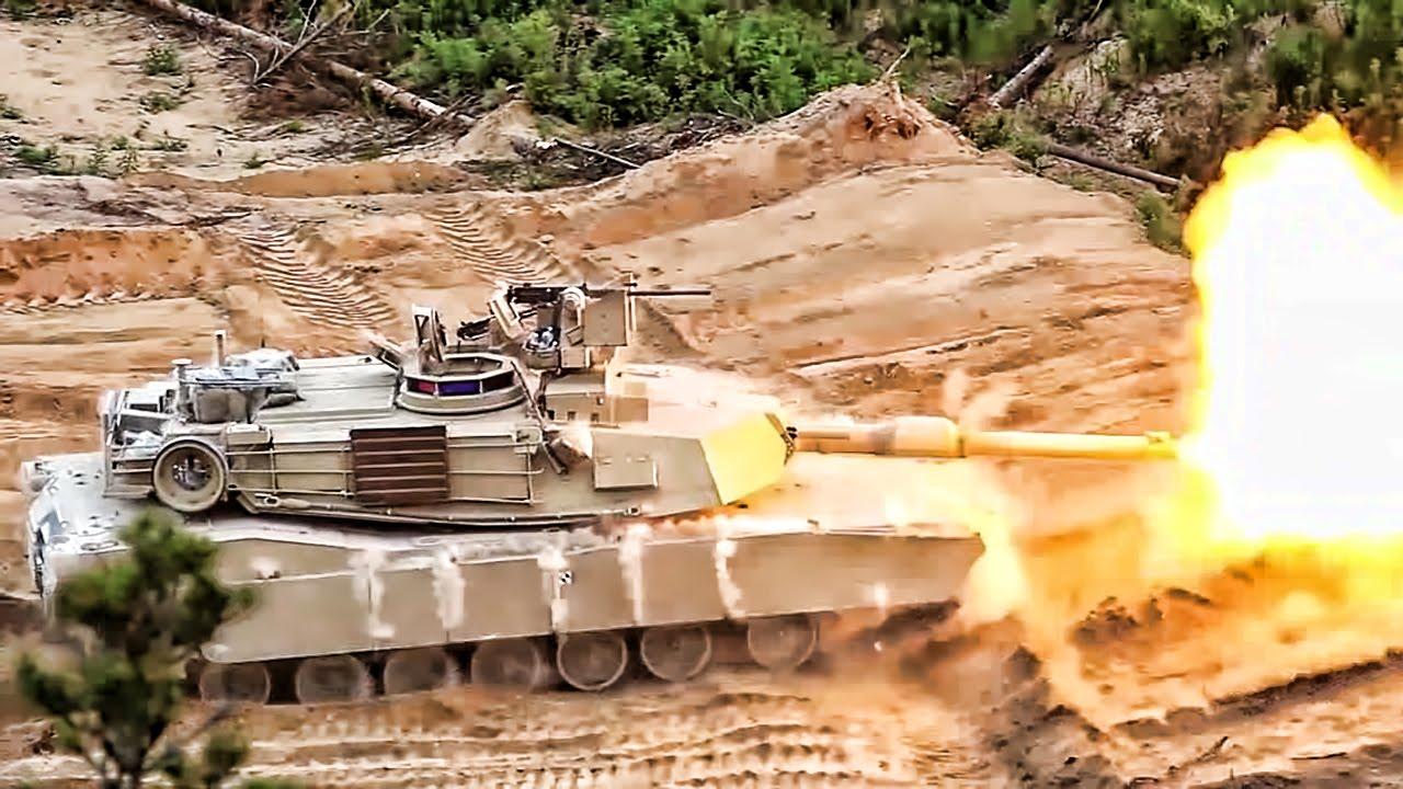 U.S. Armored Vehicles Fire & Maneuver In Estonia