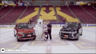 Polar bear mascot keeps slipping over on the ice