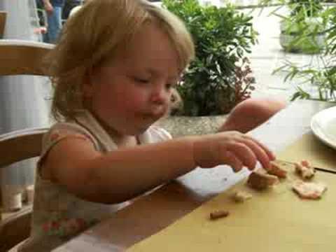 Hannah samples italian bread and pizza