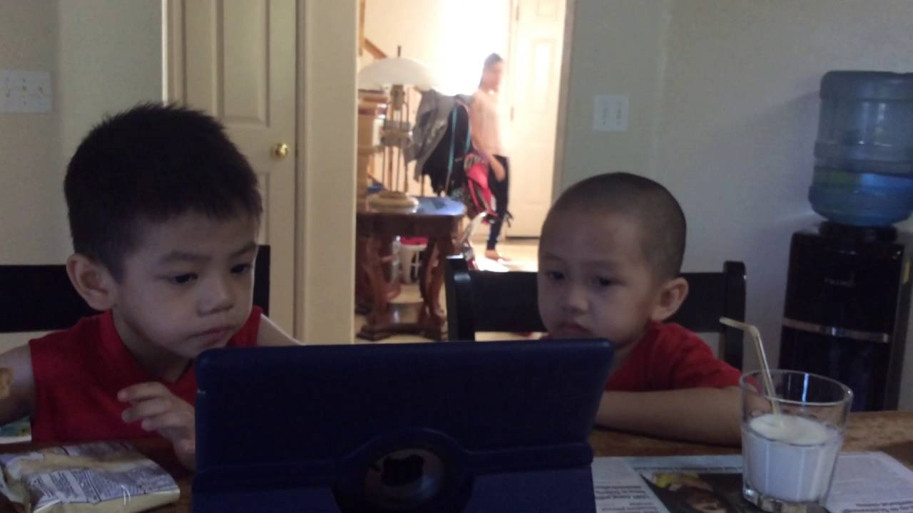 Image result for kids watching phones while eating
