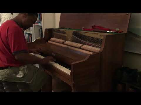 Kris Nicholson doing a Nother test drive on a Kimball upright piano after tuning it