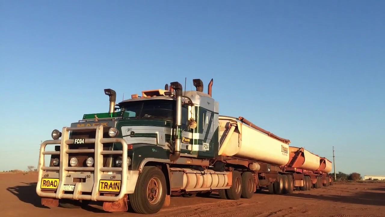 Extreme Truckers ride in Massive 650 HP CAT C16 Mack Titan triple road train