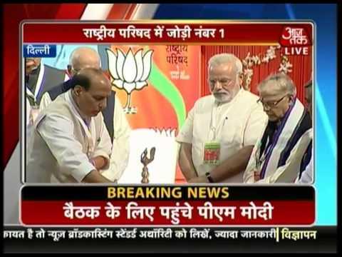 PM Modi, Advani, Rajnath Singh light the lamps at party meet