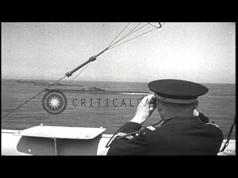 Fleet of French battleships fire torpedoes and aircraft in flight near France dur...HD Stock Footage