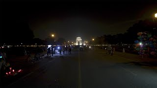 Timelapse of people walking on Rajpath in front of India Gate at night