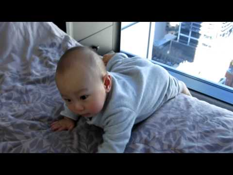 Baby Heston climbing down from bed 2