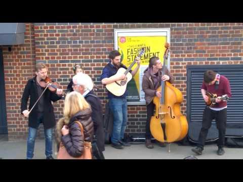 Street artist's music at the Globe, London