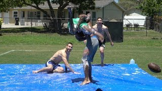 WE PLAYED A GAME OF FOOTBALL ON A SLIP AND SLIDE