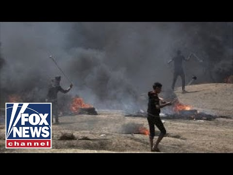 Dozens dead in US embassy protests on Gaza border