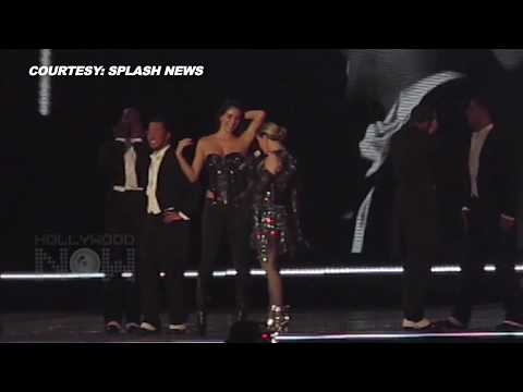 OMG! Madonna Pulls Off Female Fan's Top On Stage