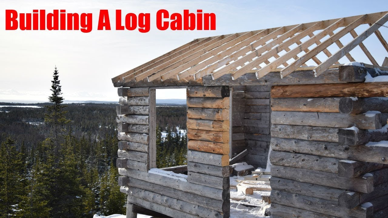 Building a log cabin begining the roof youtube for Log cabin roof construction
