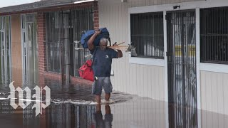 After days of flooding and power outages, North Carolinians look for help thumbnail