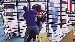 Robbery fail  Video shows cellphone employees fight off armed robbers  TomoNews