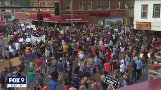 Protesters march to Minneapolis Police Department Third Precinct following death of George Floyd
