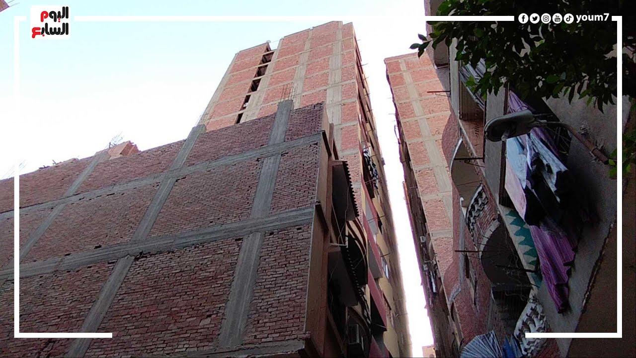 برج الهرم المائل يهدد العقارات المجاورة.. لجنة هندسية تعاين العمارة بعد إخلائها من السكان