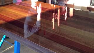The Varnish Is Applied To The 8 Seater Hardwood Dining Table By Brisbane's Lee Kenny