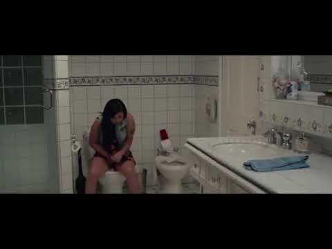 Girl on toilet peeing