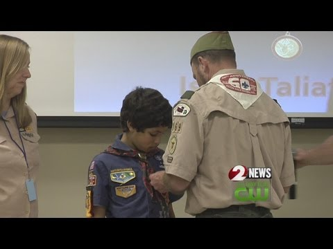 Cub Scout receives National Medal of Merit