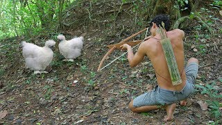 Hunting Black Chicken by Bow and Arrow - Cooking Black Chicken in Forest