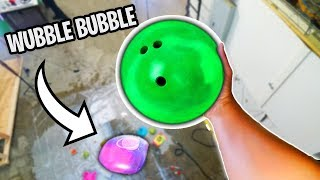 Bowling Ball VS Wubble Bubble from 100ft Drop!