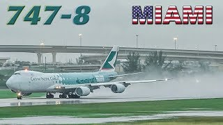 CATHAY Boeing 747-8 departs a wet MIAMI runway