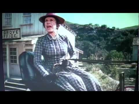 Laura Ingalls pushes Nellie Oleson down the hill