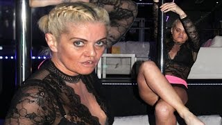 Danniella Westbrook flashes everything as she gurns while pole-dancing in VERY tiny shorts