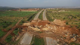 Фото Aerial Shots Show Large Roadblock On Key M4 Highway In Syria's Idlib | AFP