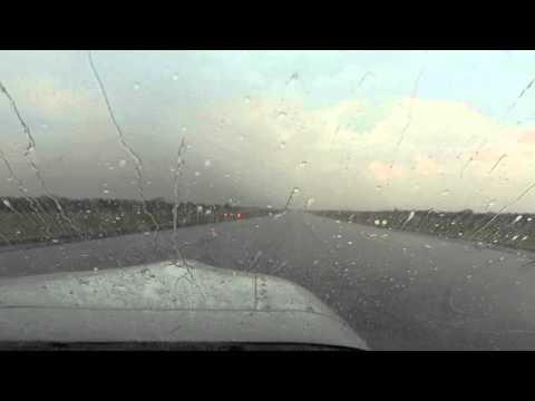 Cockpit view landing in rain storm, Livingstone, Zambia, 2015-10-03
