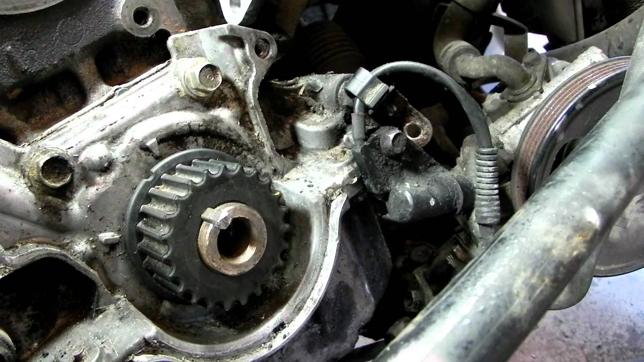 The Timing Belt And Front Oil Seal On A