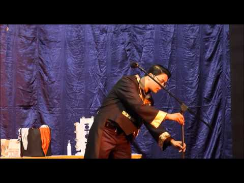 Magician Somanko performing on stage 27 Dec 2014