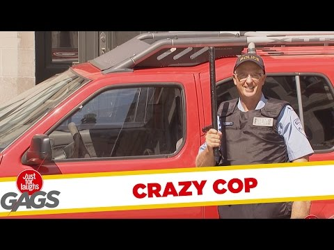 Crazy Cop Smashes Car Window