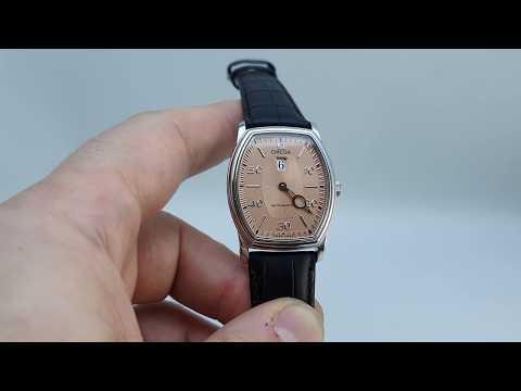 1999 Omega De Ville Prestige men's jump hour watch with salmon dial
