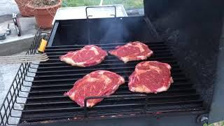 Ribeye steak on grill grates