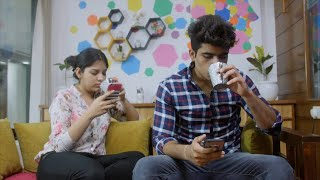 Young Indian couple spending their free time on web surfing