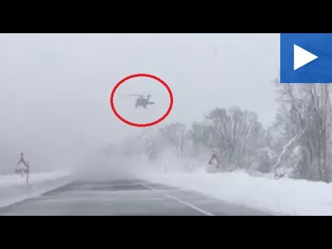 Austrian Air Force Clear Snow From Trees With Black Hawk Helicopter